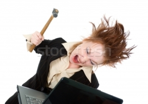 600130_stock-photo-stressed-businesswoman-smashing-her-laptop-with-a-hammer